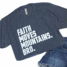 """Vintage navy unisex t-shirt with our """"Faith Moves Mountains Bro"""" block style design. FIT: Unisex - True to size. Size Bust/Chest Inches Small 34-36 Medium 38-40 Large 42-44 XL 46-48"""