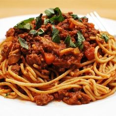 A brilliant fire and forget slow cooker Spaghetti Bolognese - throw it in the morning, leave for the day, and get home from work to an amazing dinner!