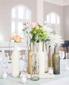 Wedding Decorative Bottles : Wine bottle centerpieces painted in gold or white with an assortment of flowers. Jessica's & Josh's Savannah wedding at Forsyth Park. Photographed by Priscilla Thomas Photography. Wine Bottle Centerpieces, Wedding Wine Bottles, Wedding Centerpieces, Wedding Table, Diy Wedding, Rustic Wedding, Wedding Flowers, Wedding Decorations, Centerpiece Ideas