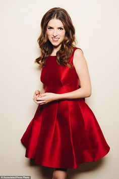 Lady in red: Anna Kendrick admits she is already in the holiday spirit as she poses at Chateau Marmont in Los Angeles, California, in a gorgeous red party dressby Kate Spade