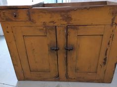 Primitive mustard paint dry sink two doors  One drawer