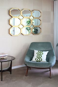 Glam mirror. Plush chair.