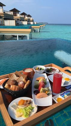 "Definitely adding ""breakfast in my overwater bungalow's private pool in the Maldives"" to my bucket list! Vacation Places, Dream Vacations, Vacation Spots, Honeymoon Places, Greece Vacation, Honeymoon Destinations, The Places Youll Go, Cool Places To Visit, Breakfast In Bed"