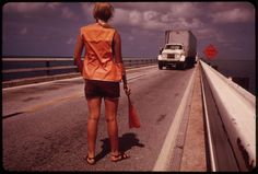 Female Road Worker Directs Traffic During Repairs on the Overseas Highway Leading to Key West. | Flickr - Photo Sharing!