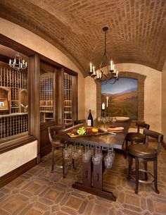 Tasting table allows you to hold some additional glasses [Design: Spectrum Interior Design / Photography: Bernard Andre] Wine Tasting Room, Tasting Table, Wine Barrel Table, Architecture Design, Stone Wall Design, Wine Cellar Design, Event Room, Interior Design Photography, Tuscan Style