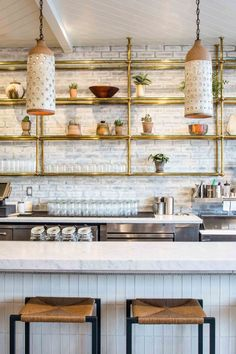 Macramé Revisted: Cafe Gratitude in Downtown LA White & Gold Bar/Kitchen Inspiration. Brass Shelving with Glass Counters. Kitchen Bar, Kitchen Design, Kitchen Shelves, Kitchen Countertops, Glass Shelves, Brass Shelving, Cafe Interior, Cafe Gratitude, Glass Shelves Decor