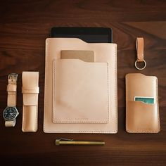 """Luscious matching natural vegetable tanned handmade leather daily essentials. Our """"Windsor"""" iPad sleeve, """"Judas"""" iPhone 6 sleeve, """"Reynolds"""" pen case, and a gorgeous Techne Merlin watch strapped to our """"Hollister"""" NATO watch strap. All leather goods available at www.basandlokes.com-SR"""