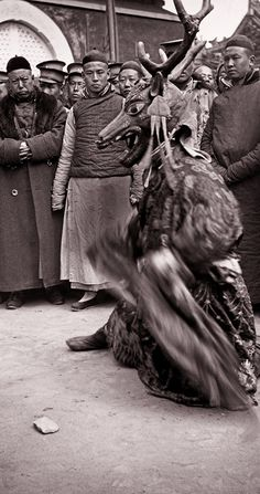 A ritual dance described as Tibetan Buddhist, likely photographed at the Yellow Temple near the since demolished Anding Gate in northern Beijing, Photo by Heinz von Perckhammer, an Austrian marine navy soldier from Meran (now in Italy) who lived in China between 1914 and 1927. After the collapse of the Austro-Hungarian Empire and his retirement from the military, he worked as a photographer in Beijing.