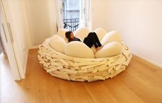 Many artists and designers mimic nature to create cool things. This Giant Birds Nest is an excellent example. Not a couch, not a bed.. something in between.