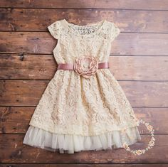 JOIN US in FB for FABULOUS WEEKLY GIVEAWAYS COUPONS AND SPECIAL OFFERS!  https://www.facebook.com/SweetValentinaBabyBoutique  BELLE DRESS   Our adorable BELLE dress is just the perfect flower girl dress for your rustic wedding or for everyday wear. Wear it with a pair of cowgirl boots for the perfect country look! This dress is fully lined and features beautiful Cream lace over a Cream underlay and a hint of ivory tulle lining the bottom. The dress is accented with adorable cap...