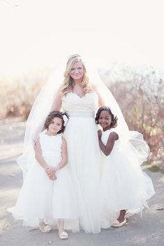 rebeccadrew_157.  Photography by Simply Bloom.  Bride's dress by Winnie Couture.  Flower girls handmade to match.