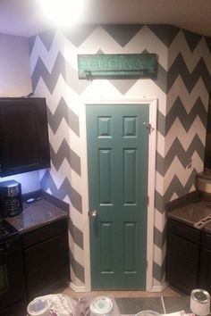 My hubby painted our pantry chevron #diy #chevron #paint #wall