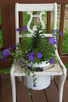 Flowers in an old chair and enamel pot