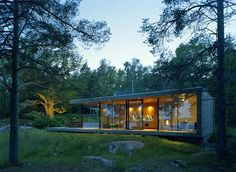 Nestled in a sculptural rocky landscape in the Swedish archipelago of Stockholm, among ancient oaks and pine trees, this modern island house merges beautifully with its surroundings without disrupting the scenic coastline.