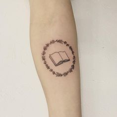 Book with rosemary wreath tattoo - Tattoo People Toronto - Jess Chen