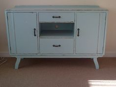 Upcycled sideboard, duck egg blue. Now a tv unit.