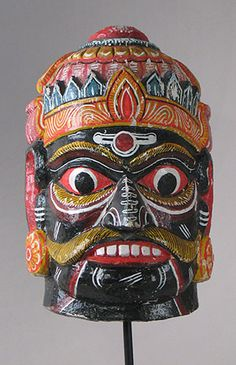 Mask....An old, large wooden festival mask depicting a Hindu god. I hope someone will correct me if it is not Krishna.