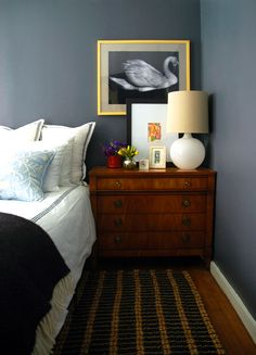 Yellow frame with black and white print against blue wall.  Little Green Notebook: Swan Prints