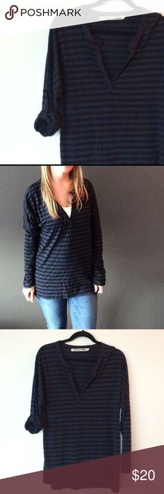 Michael Stars black and blue roll sleeve tunic top This is a fantastic top- can be worn over leggings like a tunic. Pre-owned with no major signs or wear- just normal from washing and wearing. Deep slit in front. This is a OS (one size, but will not fit all).  Measurements underarm to underarm flat across is approximately 18 inches, back of neck to bottom of hem is approximately 28 inches ( front is about 2 inches shorter). Photos show how sleeves can be rolled and buttoned or left long…