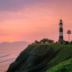 "Location: @jnasa captures the sunset at Faro la Marina (La Marina Lighthouse) - Distrito Miraflores Lima Peru. Photo Credit: @jnasa ""La Marina Lighthouse (Faro la Marina) is an active lighthouse set in on high cliffs above the Pacific Ocean in Miraflores a district of Lima the capital of Peru. The lighthouse was originally constructed in 1900 at Punta Coles a headland near Ilo in the south of Peru but in 1973 it was dismantled and reconstructed in Miraflores. It is one of the most famous…"