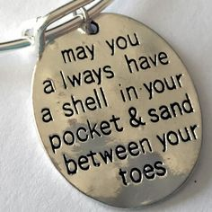 "A little sand between the toes and a shell in your pocket may be the key to happiness! ""Shell in your pocket"" Charm Details This beach charm has a wonderful hammered look and feel to it. Size: 1.2 in"