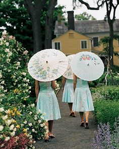 Bride Melinda's maids wore floral-print dresses and carried parasols in lieu of flowers down the aisle at her summer ceremony in Old Lyme, Connecticut.