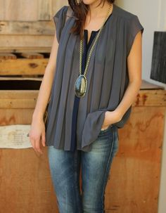 pleated blouse + stella and dot statement pendant
