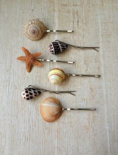 These pretty shell hair pins would be great as a set or on their own! They would be a perfect addition for a beach wedding, summer vacation, mermaid costume or for everyday fun. The shells and are securely attached to a silver metal hair pin that is two inches in length. You will