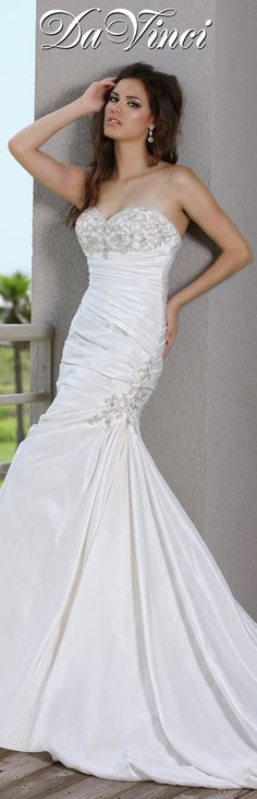 DaVinci Bridal Style # 50237 Taffeta fit and flare gown features a sweetheart strapless neckline with beaded bust.  Rouched bodice extends down to the trumpet skirt and gathers to beaded appliqué at the hip.  Lace up back and chapel length train. http://www.davincibridal.com/