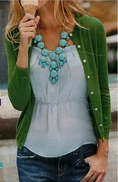 love the top/necklace/cardigan combo here - wonder what type of neckline/waistline that is?  Definitely a shirttail hem.