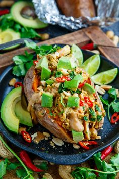 Slow Cooker Peanut Chicken Sweet Potato Boats Recipe : Tender roasted sweet potatoes stuffed with spicy peanut sauce drenched slow cooker chicken that is so easy to make and so tasty! Spicy Peanut Sauce, Peanut Butter Recipes, Sweet Potato Recipes, Chicken Recipes, Potato Boats, Slow Cooker Recipes, Cooking Recipes, Peanut Chicken, Entree Recipes