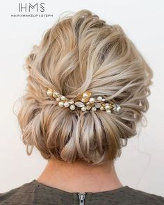 Wrapped bridal up hairstyle with pearl hairpin | 45 Glamorous Wedding updos for long and medium hair | CircleTrest