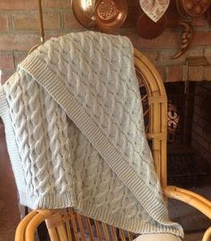 """Free knitting pattern for Reversible Cable Blanket - Knitculture.com designed this blanket that looks great from any side thanks to a reversible cable pattern. Approximately 33"""" x 33"""". Pictured project is by EveningStarDust"""