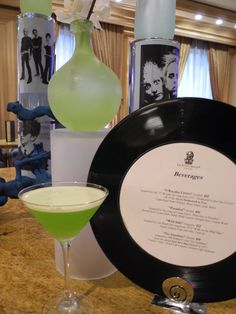 """At The Ritz-Carlton, Cleveland a new menu has been inspired by inductees into the Rock & Roll Hall of Fame. To recreate yours at home, follow the recipe for the """"Welcome to Paradise"""" Martini:   1 1/2oz*Bacardi Rock Coconut Rum ¾ oz*Midori Melon Liqueur ¾ oz*Pineapple Juice *Coconut Water"""