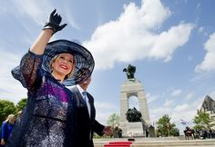 A smiling Queen Máxima waves the crowds in Canada, as she and husband King Willem-Alexander arrives on a state visit.