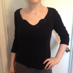 Anthropologie Odille M Black Top with Sequin Neck Excellent Used Condition. Size Medium. 3/4 sleeves. Neckline is asymmetric with black diamond-shape sequin accents. Perfect to tuck into a sparkly skirt for holiday parties. No defects or imperfections. Anthropologie Tops Tees - Long Sleeve