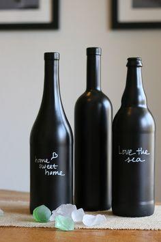 Decoration: Fascinating Triple Black Chalkboard Wine Bottles On Wooden Table.