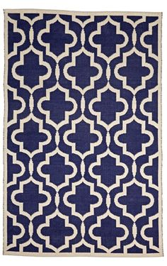 Shop Navy Fretwork Kids Rug.  Interlaced shapes come together to form the intricate pattern on our Fretwork Rug.  This rug was made by hand, and it's perfect for a playroom, kids room, or even a living room.