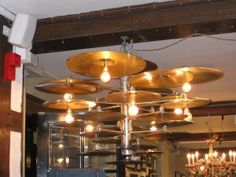 Cymbals make great lamp shades- they reflect the light downwards.