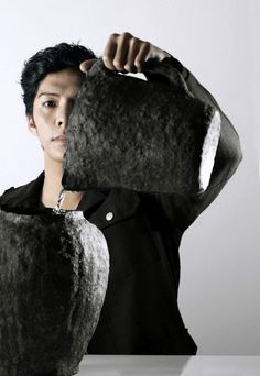 Dutch designer Jo Meesters has developed a collection of vessels made from waste paper pulp.