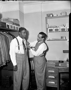Fashion Mart--Jackie Robinson being fitted. 1940 - 1950