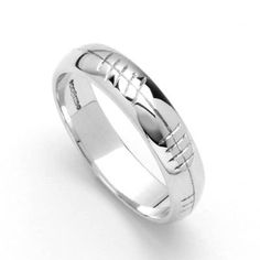 This beautiful Irish wedding ring features classic Ogham writing, which is a medieval form of writing the Irish alphabet.  Ladies Ogham Engraved Rounded Irish Wedding Ring - Silver - Size 7  Price : $163.96 http://www.biddymurphy.com/Ladies-Ogham-Engraved-Rounded-Wedding/dp/B00IXODQVU