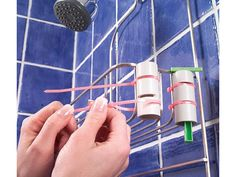 """DIY Bathroom Solutions:  """"Use PVC piping to hold razors  -- Keep your razor from falling into the tub with this simple holder. Cut a 3-in. length of 1-in. PVC pipe with a handsaw. Cut two 1/8-in.-wide notches in the pipe. Strap the pipe to your wire shower caddy with two plastic tie straps hooked in the notches. Drop the razor into the pipe; the blade will catch on the edges of the pipe, keeping the razor off the floor."""""""