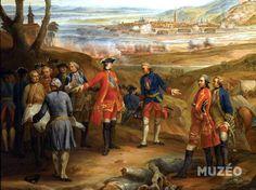 """Il s'agit en fait d'une copie d'une partie de ce tableau de Pierre LENFANT, intitulé """"Siège et prise de Fribourg"""" (1744) commandé par Louis XV (ici au centre), et conservé au Château de Versailles. Découvrez les reproductions de toiles historiques proposées par MUZEO : http://fr.muzeo.com/reproduction-oeuvre/le-si%C3%A8ge-et-la-prise-de-fribourg-en-brisgau-11-octobre-1744/lenfant-pierre-2"""