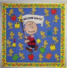 Charlie Brown BB-Welcome to __. This is really similar to my classroom door.  I have Snoopy surrounded by flying Woodstocks.  Each bird has a student's name on it.