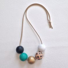 Modern Geometric Wood Bead Necklace. Love this! DIY and save. Get your beads at www.fizzypops.com!