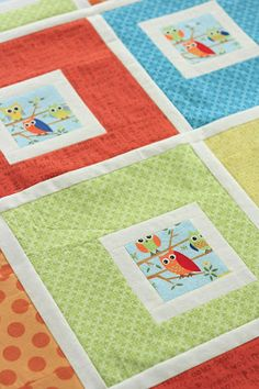 Project 12 Quilts: Little Owls baby quilt pattern / tutorial fussycut center (accentuated with white border sashing) is always off-center to nice effect with 4 simple side bands in 2 widths