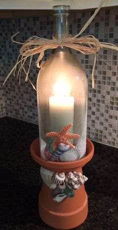 Upcycled wine bottle terra cotta candle by RhonaPonaRelics on Etsy