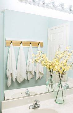 Bathroom Shelf Makeover with DIY towel rack. Get a spa look and great…