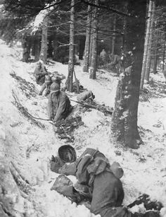 GIs digging hasty foxholes near Berisment. For the soldier in the foreground it was too late. 6 january 1945.